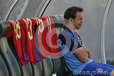 Football Player Sitting On The Bench Editorial Stock Image