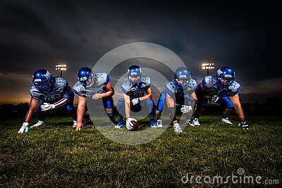 Football Players In Blue Jersey Lined Under Grey White Cloudy Sky During Sunset Free Public Domain Cc0 Image