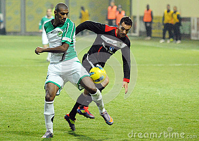 Football players fight for the ball in Concordia Chiajna-Gaz Metan Medias Editorial Stock Photo