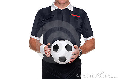 Football referee holding a ball and whistle