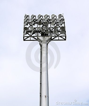 A football stadium floodlight with metal pole