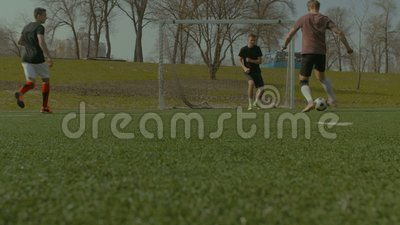 Football team scoring a goal during training match stock footage