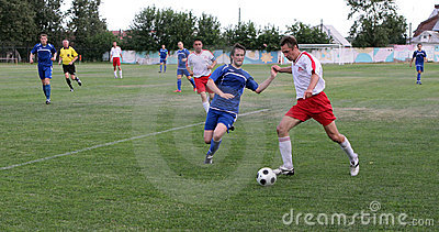 Football. Violent struggle Editorial Stock Photo