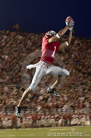 Football Wide Receiver Making a Leaping Catch