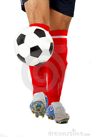 Footballer legs playing with a ball