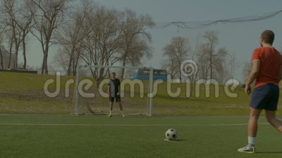 Footballer scoring a goal after penalty kick stock video footage