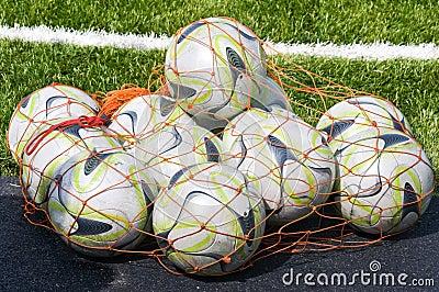 Footballs.