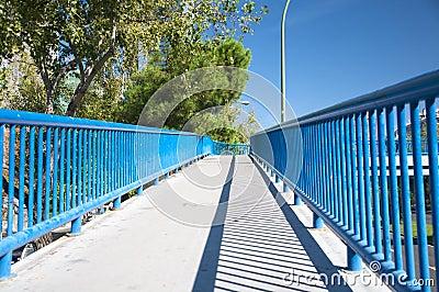 Footbridge with blue railing