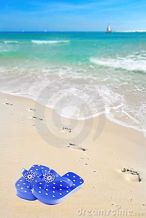 Footprints by flipflops on Beach