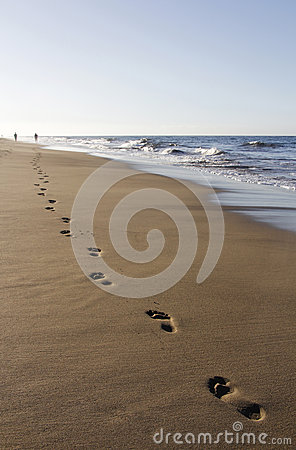 Runner footprints on sand
