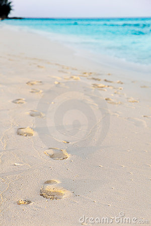 Footprints in tropical beach