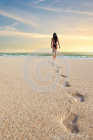 Footprints of a woman on the beach