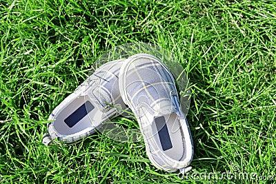 Footwear on a juicy grass