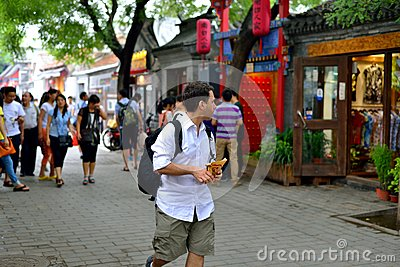 A foreign man in Beijing hutong tour Editorial Stock Image