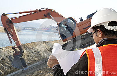 Foreman construction and excavator driver working