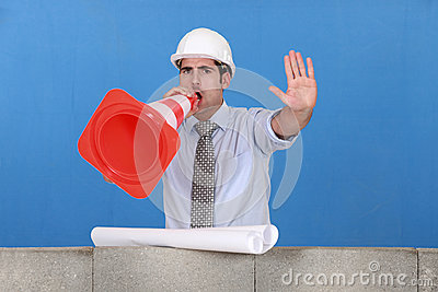 Foreman screaming into cone