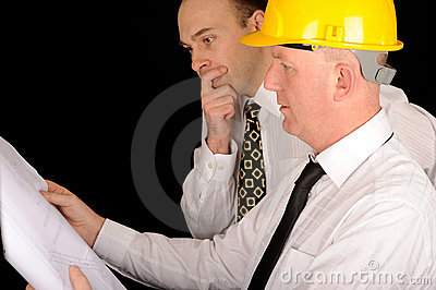Foremen looking at plans