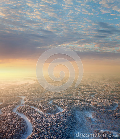 Forest river with beautiful sunrise in winter