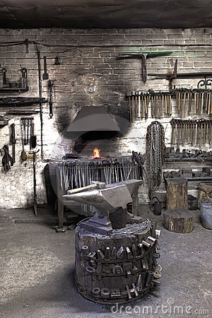Forge with anvil and hammers.