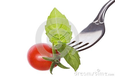 Fork with basil and tomato