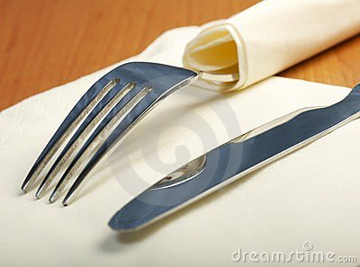 Fork and a knife lie on serviette