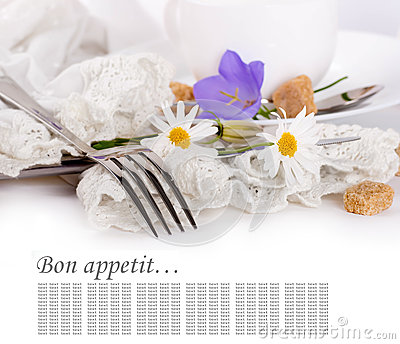 Fork and knife in a napkin, flower