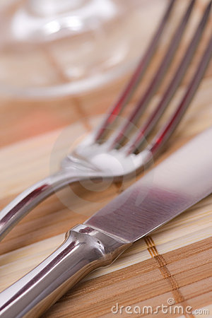Fork and knife on placemat