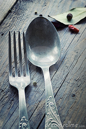 Fork and knife in rustic setting