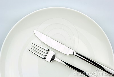 Fork and knife,  on white plate
