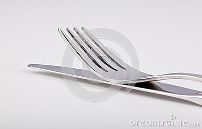 Fork lying on top of the knife