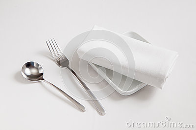 Fork,spoon,dish and  tablecloth