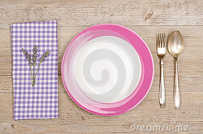 Fork and spoon with violet napkin