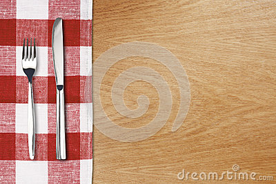Fork and tableknife on red gingham tablecloth
