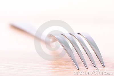 Fork on wooden table