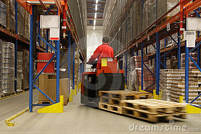 Forkift operator in warehouse