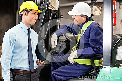 Forklift Driver Communicating With Supervisor