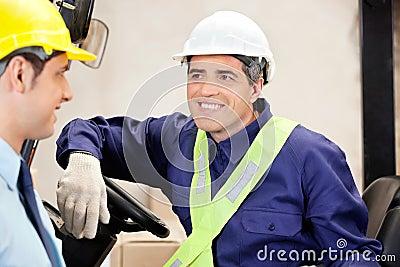 Forklift Driver Looking At Supervisor