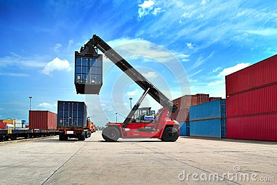 Forklift handling the container