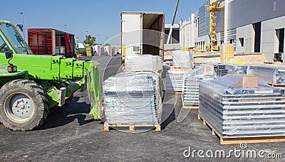 Forklift loading pallets