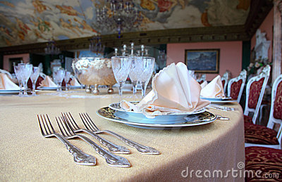 Forks and plates with placemat at dinner table