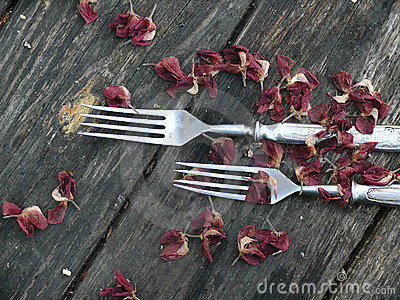 Forks. A tableware. An old wooden table.