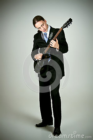 Formal man playing on guitar