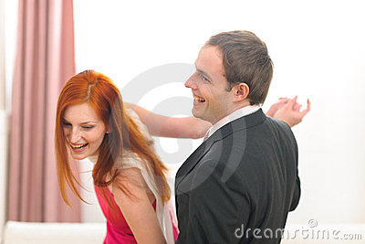 Formally dressed young couple having fun dancing