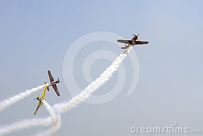 Formation of YAK 52 airplanes at Romanian Air Show Editorial Stock Image