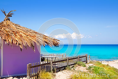 Formentera tropical purple hut on turquoise beach