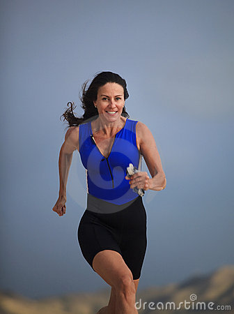 Forty year old female triathlete running