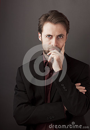 Forty years old businessman standing on a grey background