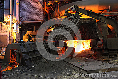 Foundry with red hot melting pig iron in Russia