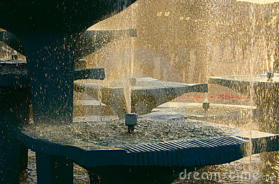 Fountain against bright sun