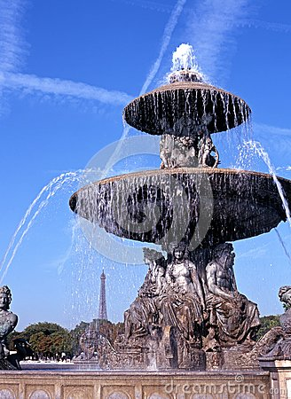 Fountain and Eiffel Tower, Paris, France.